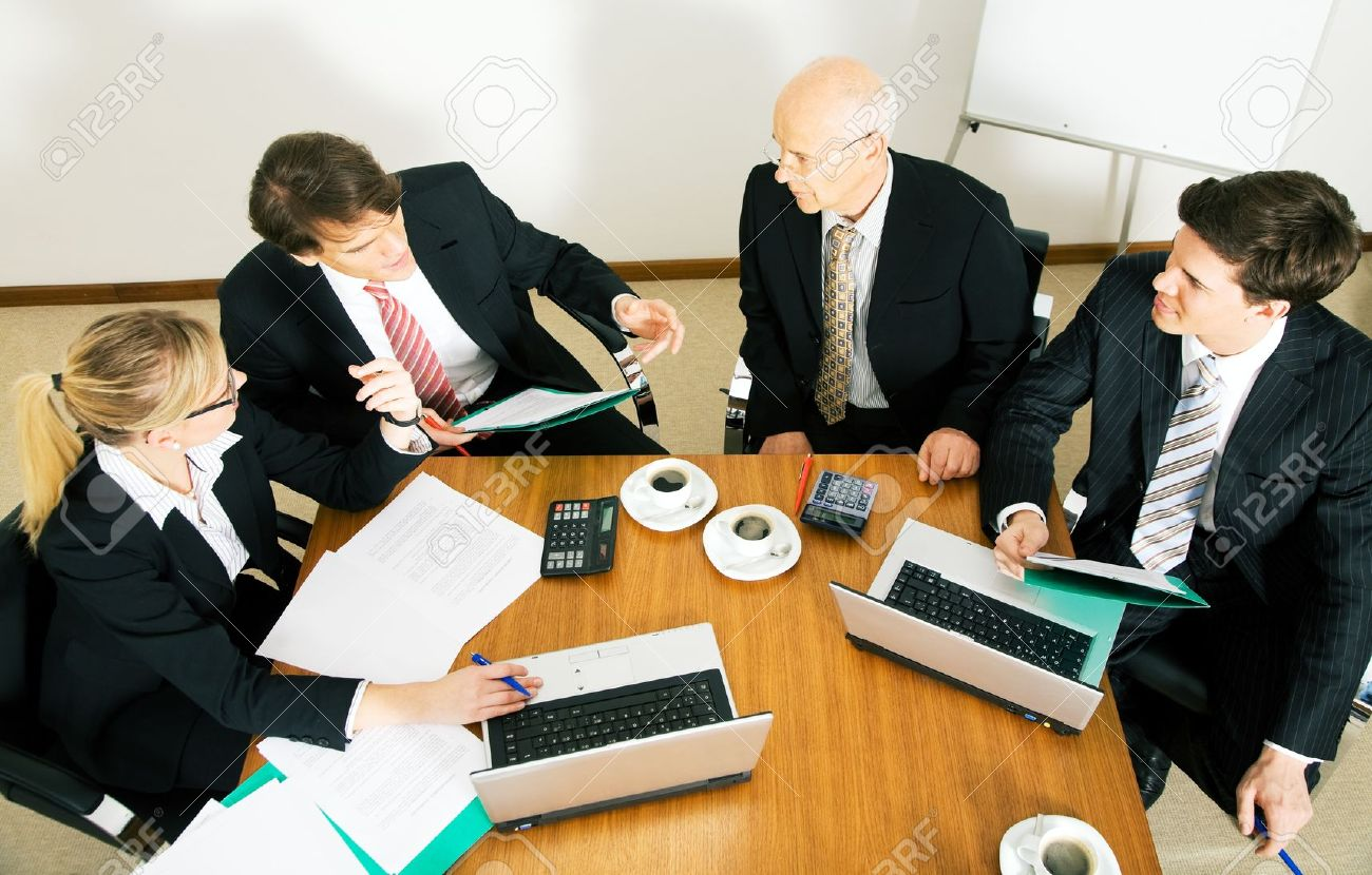 10305980-businesspeople-crunching-the-numbers-of-a-business-plan